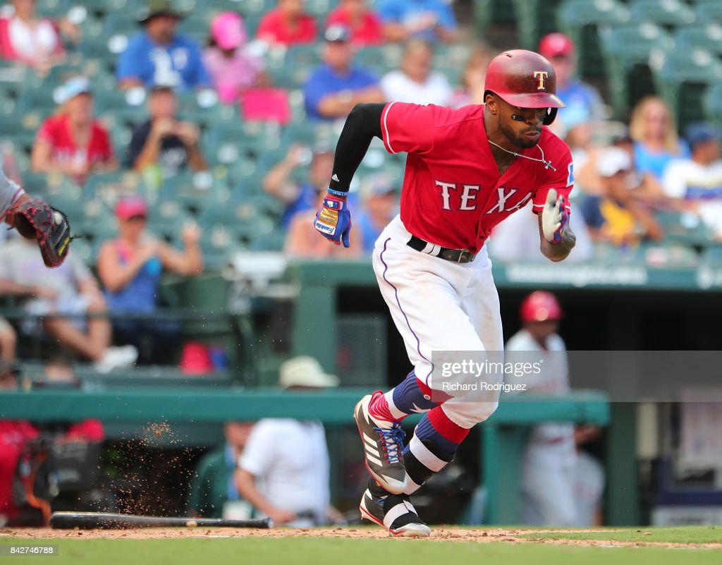 Delino DeShields #3 of the Texas Rangers runs to first after a bunt against the Los Angeles Angels of Anaheim at Globe Life Park in Arlington on September 3, 2017 in Arlington, Texas.