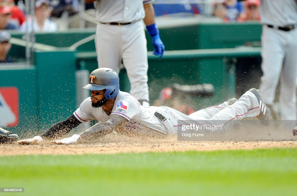 Delino DeShields #3 of the Texas Rangers scores on a passed ball in the eighth inning against the Washington Nationals at Nationals Park on June 11, 2017 in Washington, DC. Texas won the game 5-1.