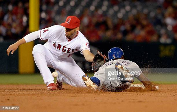 Delino DeShields of the Texas Rangers steals second base as Andrelton Simmons of the Los Angeles Angels of Anaheim waits for the ball on a throw from...