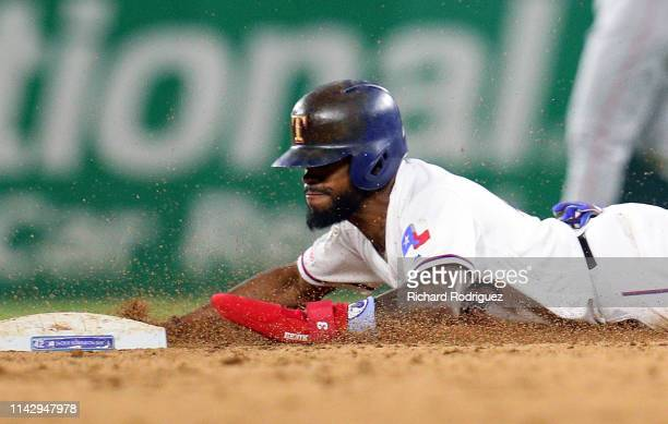 Delino DeShields of the Texas Rangers steals second base in the fifth inning against the Los Angeles Angels at Globe Life Park in Arlington on April...