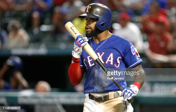 Delino DeShields of the Texas Rangers walks to the plate for an at bat against the Oakland Athletics during the seventh inning at Globe Life Park in...