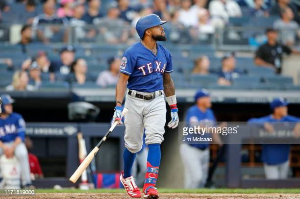 Delino DeShields of the Texas Rangers watches the flight of his eighth inning three run home run against the Texas Rangers at Yankee Stadium on...