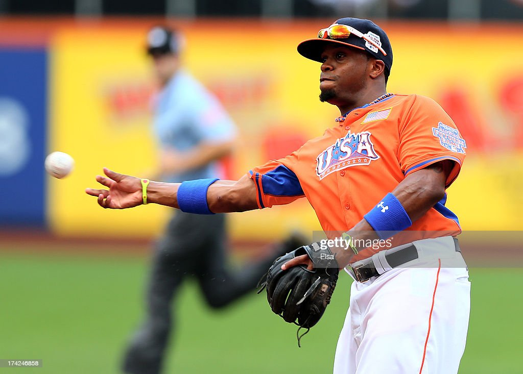 Delino DeShields #11 of the United States fields the ball during the game against the World Team on July 14, 2013 at Citi Field in the Flushing neighborhood of the Queens borough of New York City. The United States defeated the World Team 4-2.