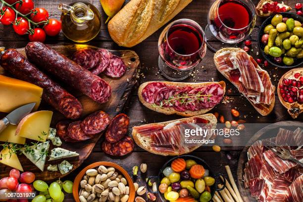 deliscious appetizer on rustic wood table - delicatessen stock pictures, royalty-free photos & images