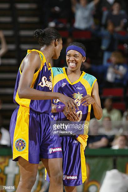 DeLisha Milton and Nicky McCrimmon of the Los Angeles Sparks laugh with each other during the game against the Seattle Storm on June 18 2002 at Key...