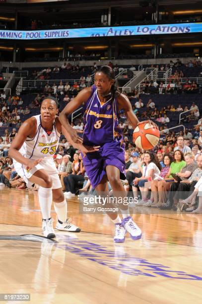 Delisha Milton Jones of the Los Angeles Sparks drives against Le'coe Willingham of the Phoenix Mercury on July 17 at US Airways Center in Phoenix...