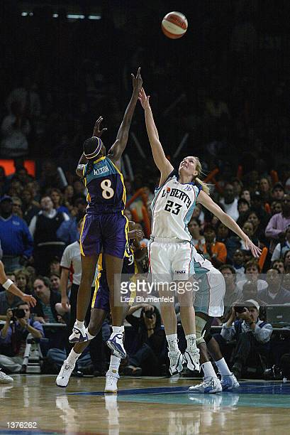 Delisha Milton of the Los Angeles Sparks puts a shot up over Sue Wicks of the New York Liberty in game one of the 2002 WNBA Finals on August 29 2002...