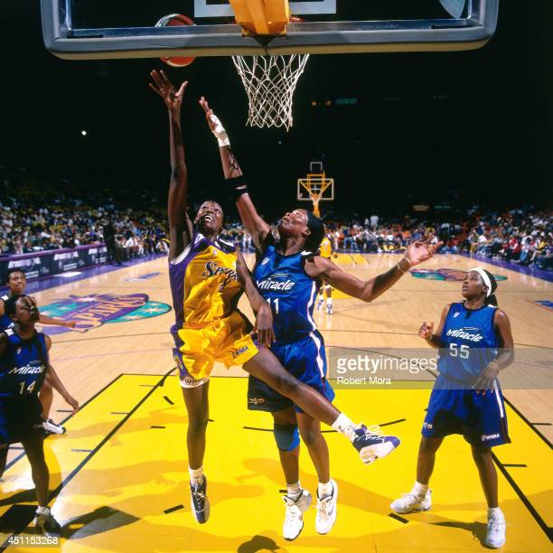 Delisha Milton of the Los Angeles Sparks shoots against the Orlando Miracle at Staples Center July 22 1999 in Los Angeles CA NOTE TO USER User...