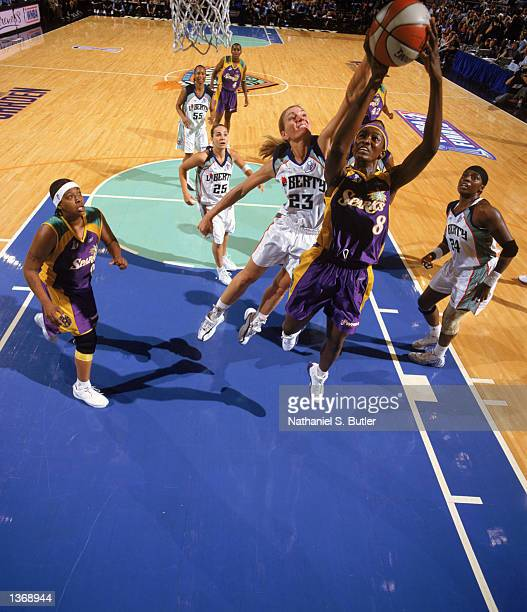 DeLisha Milton of the Los Angeles Sparks shoots past Sue Wicks of the New York Liberty during Game 1 of the 2002 WNBA Finals on August 29 2002 at...