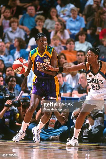 Delisha Milton of the Western Conference dribbles during the 2000 WNBA AllStar Game on July 17 2000 at America West Arena in Phoenix Arizona NOTE TO...