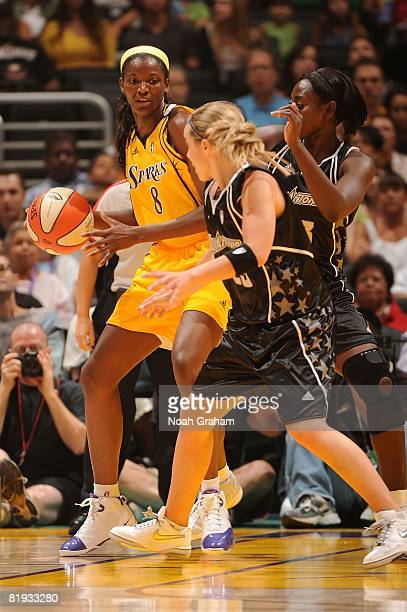 DeLisha MiltonJones # #8 of the Los Angeles Sparks handles the ball during the game against Becky Hammon of the San Antonio Silver Stars at Staples...