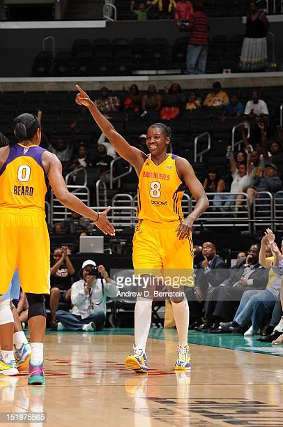 DeLisha MiltonJones and Alana Beard of the Los Angeles Sparks celebrate during a game against the Chicago Sky at Staples Center on September 13 2012...