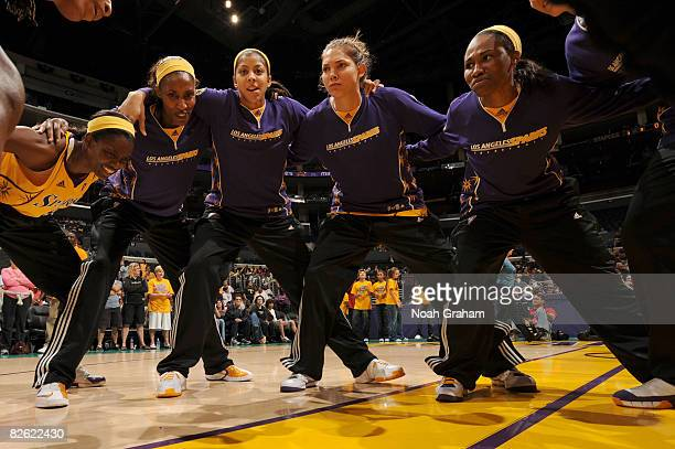 DeLisha MiltonJones Lisa Leslie Candace Parker Sidney Spencer and Tameka Johnson of the Los Angeles Sparks huddle together before taking on the...
