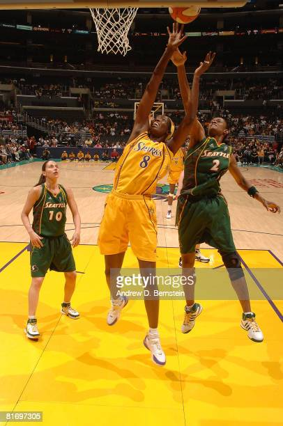 DeLisha MiltonJones of the Los Angeles Sparks blocks a shot during the game from Swin Cash of the Seattle Storm on June 24 2008 at Staples Center in...