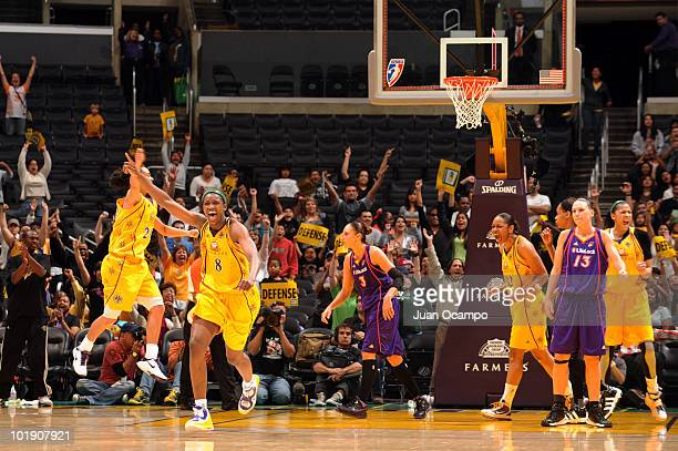 DeLisha MiltonJones of the Los Angeles Sparks celebrates the Sparks' 9291 win over the Phoenix Mercury on June 8 2010 at Staples Center in Los...
