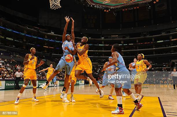 Delisha Milton-Jones of the Los Angeles Sparks collides with Kasha Terry of the Atlanta Dream on September 11, 2008 at Staples Center in Los Angeles,...
