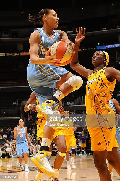 DeLisha MiltonJones of the Los Angeles Sparks defends as Armintie Price of the Chicago Sky goes up for a shot during game on June 18 2008 at Staples...