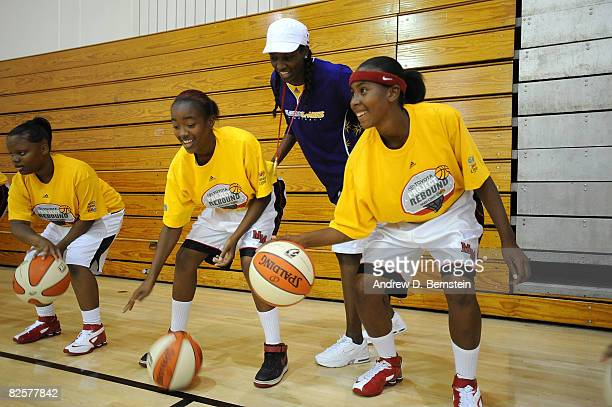 Delisha MiltonJones of the Los Angeles Sparks gives basketball handling instruction to participants at the 'Project Rebound' clinic on August 27 2008...