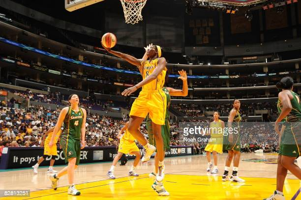 Delisha MiltonJones of the Los Angeles Sparks makes a layup against the Seattle Storm on September 14 2008 at Staples Center in Los Angeles...