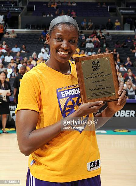 DeLisha MiltonJones of the Los Angeles Sparks poses for a photo after receiving the WNBA Cares Community Assist Award for August before the game...