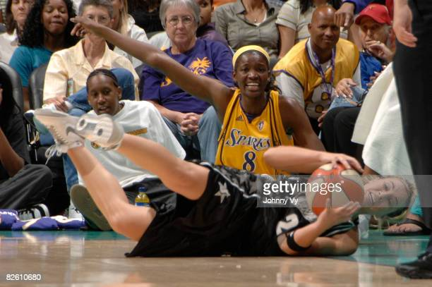 DeLisha MiltonJones of the Los Angeles Sparks signals while Becky Hammon of the San Antonio Silver Stars falls to the ground during their game on...
