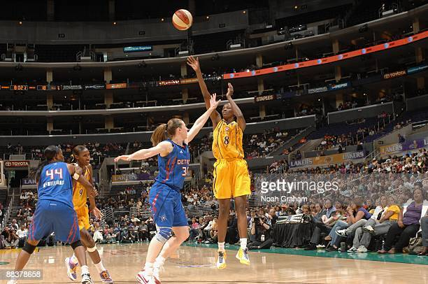 DeLisha MiltonJones of the Los Angeles Sparks takes a jump shot against Katie Smith of the Detroit Shock during the game on June 6 2009 at Staples...