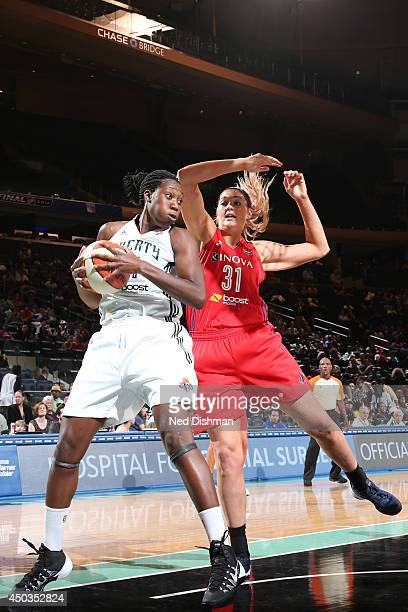 DeLisha MiltonJones of the New York Liberty grabs a rebound against the Washington Mystics at Madison Square Garden on June 8 2014 in New York NY...