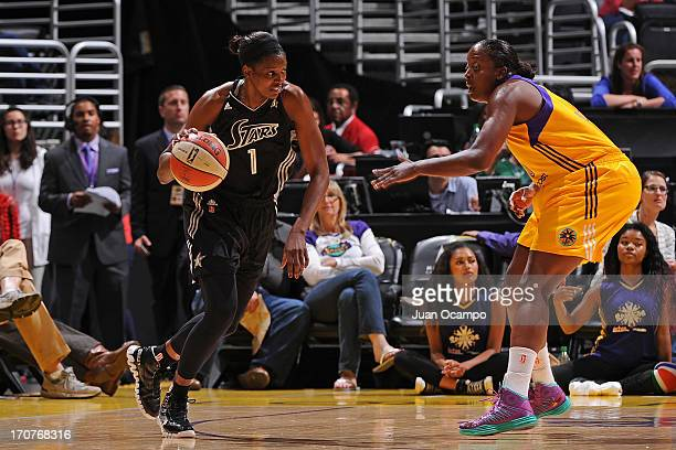 DeLisha MiltonJones of the San Antonio Silver Stars drives to the basket against the Los Angeles Sparks at Staples Center on June 15 2013 in Los...