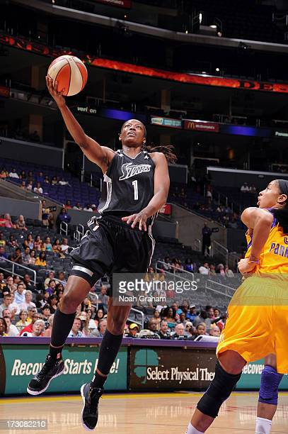 Delisha MiltonJones of the San Antonio Silver Stars gets to the hoop against the Los Angeles Soparks at Staples Center on July 6 2013 in Los Angeles...