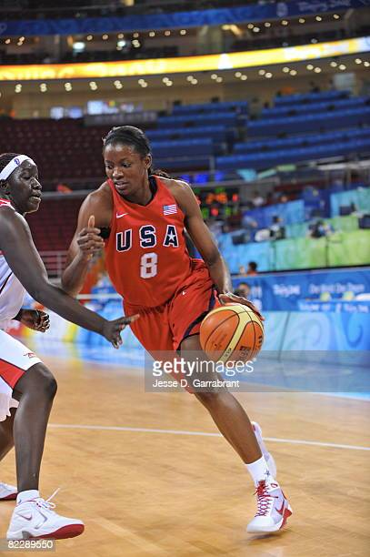 DeLisha MiltonJones of the US Women's Senior National Team drives against Mali during day 3 of women's preliminary basketball at the 2008 Beijing...