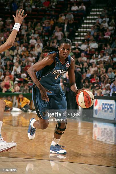 DeLisha MiltonJones of the Washington Mystics drives against the Seattle Storm on August 3 2006 at Key Arena in Seattle Washington The Storm won 8678...