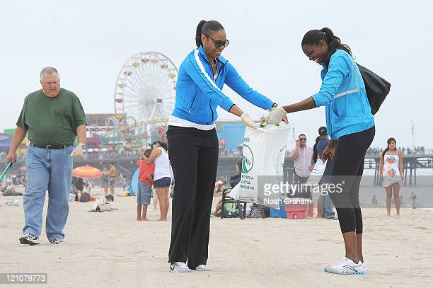 DeLisha MiltonJones and Tina Thompson of the Los Angeles Sparks join forces with Waste Management and Heal the Bay to clean up Santa Monica beach as...