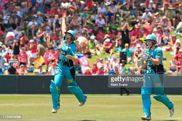 Delissa Kimmince and Laua Harris of the Heat celebrate their win during the Women's Big Bash League Final between the Sydney Sixers and the Brisbane...