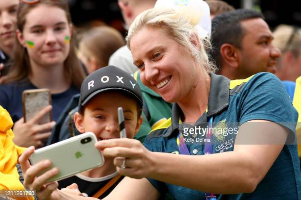 Delissa Kimmince fo the Australian Women's T20 World Cup team greets supporters after winning the ICC Women's T20 World Cup Final, at Federation...