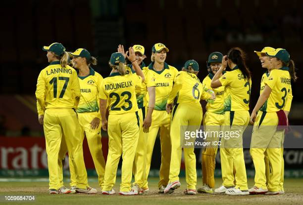 Delissa Kimmince of Australia celebrates a run out with team mates during the ICC Women's World T20 2018 match between Australia and Pakistan at...