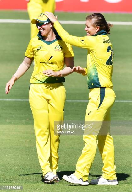 Delissa Kimmince of Australia clelbrates catching Jess Jonassen of Australia fourth wicket of Amelia Kerr of New Zealand during game two of the One...