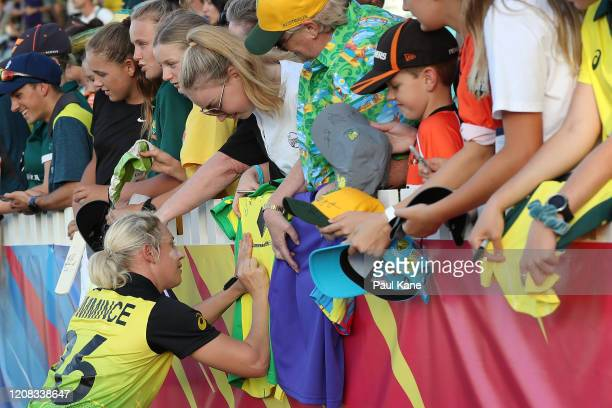 Delissa Kimmince of Australia signs autographs after winning the ICC Women's T20 Cricket World Cup match between Australia and Sri Lanka at the WACA...