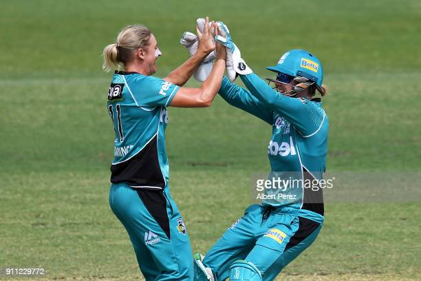 Delissa Kimmince of the Heat celebrates with Beth Mooney after dismissing Stefanie Taylor of the Thunder during the Women's Big Bash League match...