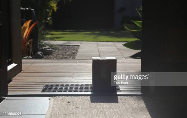 a delivered box left at the front door - sunshine coast australia stock pictures, royalty-free photos & images
