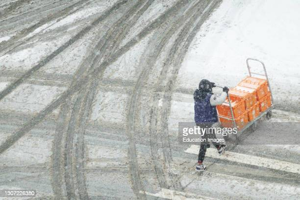 Deliveries during snowstorm, Manhattan, New York.