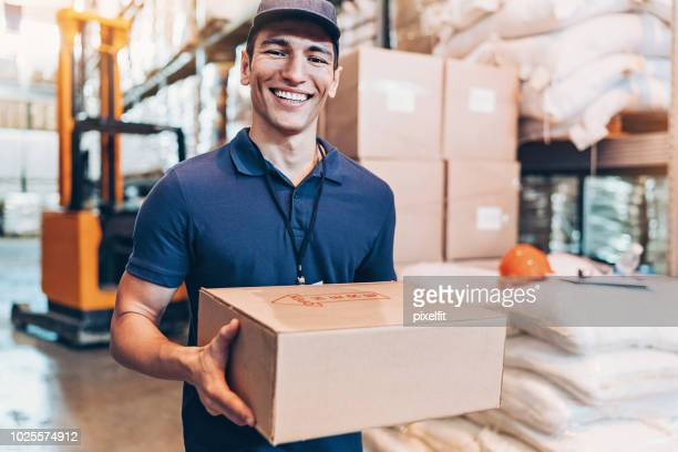 deliveries man - polo shirt stock pictures, royalty-free photos & images