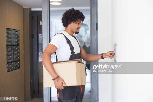 delivering a package - intercom stock pictures, royalty-free photos & images