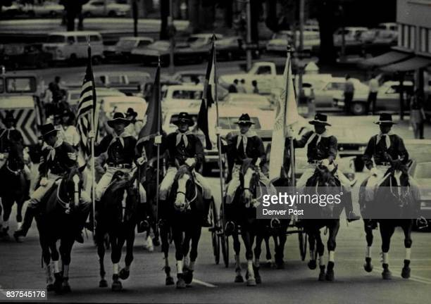 Delivering Invitation To The Fair A line of mounded cavalry color guardsmen from Ft Carson Colo rides in parade from Currigan Exhibition Hall to the...