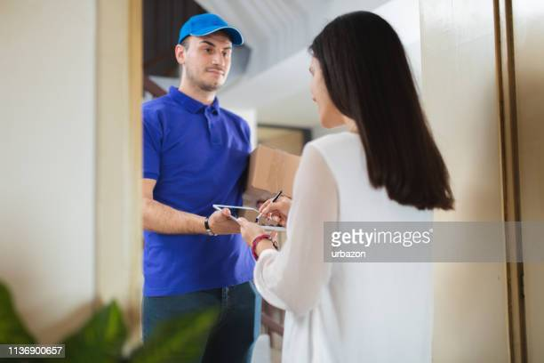 delivering package to a woman - adults only stock pictures, royalty-free photos & images