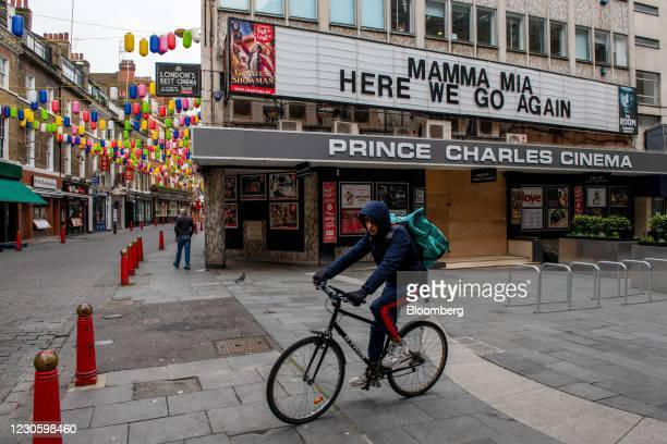 Deliveroo cyclist passes a closed cinema on the edge of Chinatown and Leicester Square in London, U.K., on Friday, Jan. 15, 2021. Londoners have...