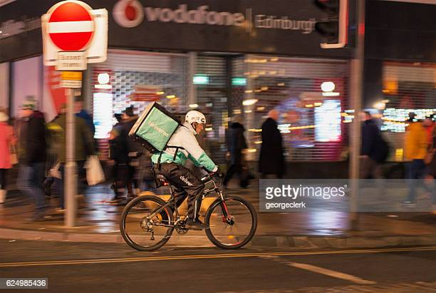 Deliveroo cyclist working at night