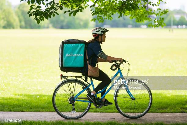 Deliveroo rider cycles through Bute Park in Cardiff on June 16 2019 in Cardiff United Kingdom
