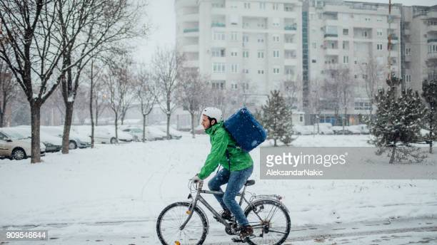 delivery boy on a bike - bicycle messenger stock pictures, royalty-free photos & images