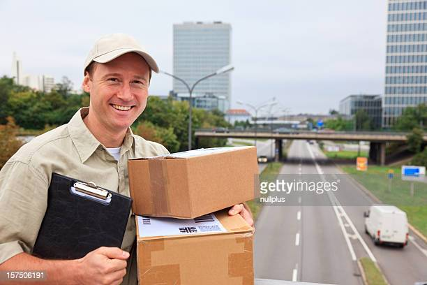 delivery boy standing on a bridge