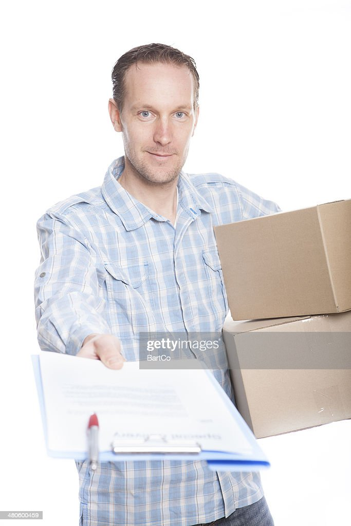 Delivery courier delivering package : Stock Photo